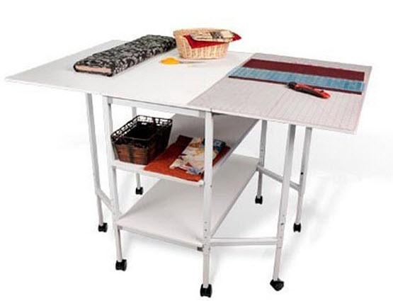 Folding fabric cutting table - b